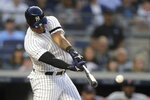 New York Yankees' Aaron Hicks hits a two-run single off Boston Red Sox starting pitcher Chris Sale during the third inning of a baseball game Friday, May 31, 2019, in New York. Yankees' Brett Gardner and DJ LeMahieu scored on the hit. (AP Photo/Julio Cortez)