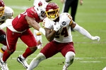 Washington Football Team running back Antonio Gibson (24) runs for a touchdown as Arizona Cardinals outside linebacker Devon Kennard (42) defends during the second half of an NFL football game, Sunday, Sept. 20, 2020, in Glendale, Ariz. (AP Photo/Darryl Webb)