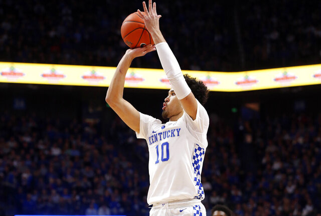 Kentucky's Johnny Juzang (10) takes an uncontested shot during an NCAA college basketball game against Georgia in Lexington, Ky., Tuesday, Jan 21, 2020. (AP Photo/James Crisp)