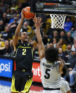 Oregon forward Louis King, left, drives the lane to the rim as Colorado guard D'Shawn Schwartz defends in the first half of an NCAA college basketball game Saturday, Feb. 2, 2019, in Boulder, Colo. (AP Photo/David Zalubowski)