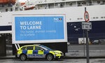 FILE - In this Feb. 2, 2021 file photo, police patrol the port of Larne, Northern Ireland. Tense post-Brexit relations between Britain and the European Union face further strain on Wednesday, July 21, 2021, when the U.K. calls for major changes to trade rules agreed on by both sides, Brexit minister David Frost will set out proposals for smoothing trade arrangements for Northern Ireland, the only part of the U.K. that has a land border with the 27-nation bloc. (AP Photo/Peter Morrison, file)