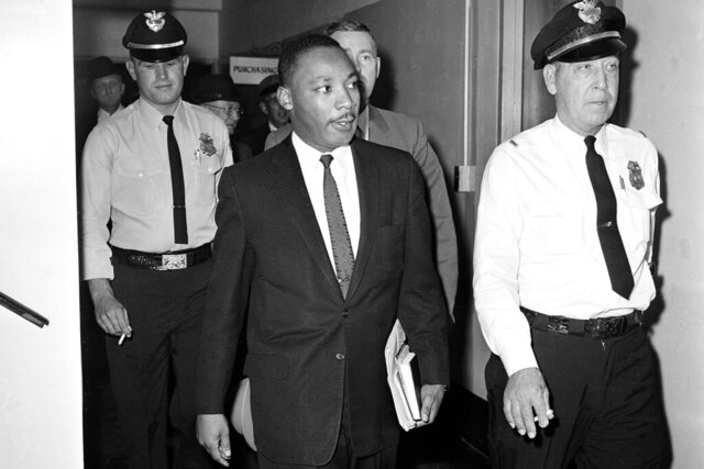 FILE - In this Oct. 25, 1960 file photo, Dr. Martin Luther King Jr. leaves court after being given a four-month sentence in Decatur, Ga., for taking part in a lunch counter sit-in at Rich's department store. Following the publication of