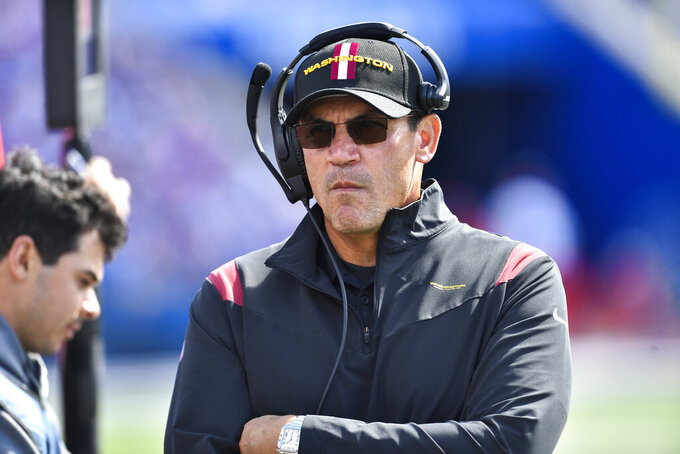 Washington Football Team head coach Ron Rivera reacts during the first half of an NFL football game against the Buffalo Bills, Sunday, Sept. 26, 2021, in Orchard Park, N.Y. (AP Photo/Adrian Kraus)