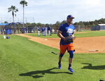 New York Mets' Tim Tebow jogs up the first baseline at spring training baseball practice Saturday, Feb. 16, 2019, in Port St. Lucie, Fla. (AP Photo/Mike Fitzpatrick)