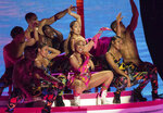 FILE - This Nov. 4, 2018 file photo shows singer Nicki Minaj performing at the European MTV Awards in Bilbao, Spain. Minaj,  who has dated Kenneth Petty for about a year, seemed to confirm her marriage with a video on Instagram on Monday that showed off Mr. and Mrs. coffee mugs and bride and groom hats. The rapper also changed her Twitter name to Mrs. Petty. (Photo by Vianney Le Caer/Invision/AP, File)
