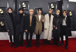"FILE - BTS arrives at the 62nd annual Grammy Awards in Los Angeles on Jan. 26, 2020. The K-pop band is nominated for a Grammy Award for best pop duo/group performance with ""Dynamite,"