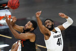 Oregon State's Maurice Calloo, left, and Colorado's Jeriah Horne (41) vie for a rebound during the first half of an NCAA college basketball game in the championship of the Pac-12 men's tournament Saturday, March 13, 2021, in Las Vegas. (AP Photo/John Locher)