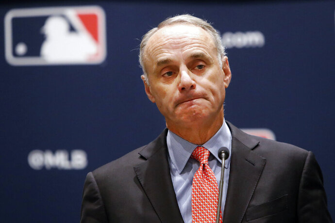 Baseball commissioner Rob Manfred pauses while speaking to the media at the owners meeting in Arlington, Texas, Thursday, Nov. 21, 2019. (AP Photo/LM Otero)