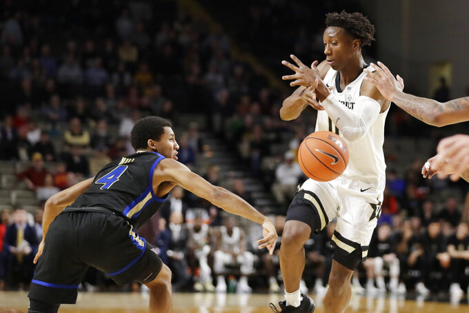 Tulsa guard Isaiah Hill (4) knocks the ball away from Vanderbilt guard Saben Lee (0) during the first half of an NCAA college basketball game Saturday, Nov. 30, 2019, in Nashville, Tenn. (AP Photo/Mark Humphrey)