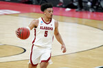 Alabama's Jaden Shackelford moves the ball against Maryland during the first half of a college basketball game in the second round of the NCAA tournament at Bankers Life Fieldhouse in Indianapolis Monday, March 22, 2021. Shackelford scored 21 points as Alabama won 96-77. (AP Photo/Mark Humphrey)