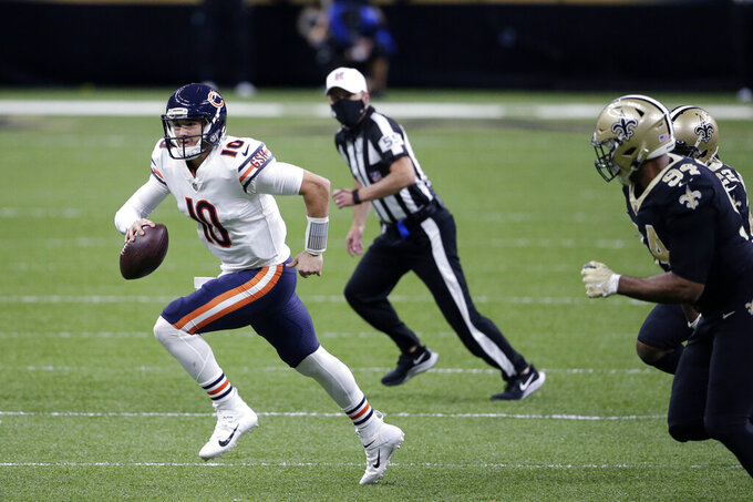 Chicago Bears quarterback Mitchell Trubisky (10) scrambles from New Orleans Saints defensive end Cameron Jordan (94) in the first half of an NFL wild-card playoff football game in New Orleans, Sunday, Jan. 10, 2021. (AP Photo/Butch Dill)