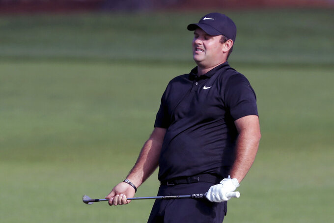 Patrick Reed reacts to his shot on the second hole during the final round of the Masters golf tournament Sunday, Nov. 15, 2020, in Augusta, Ga. (Curtis Compton/Atlanta Journal-Constitution via AP)