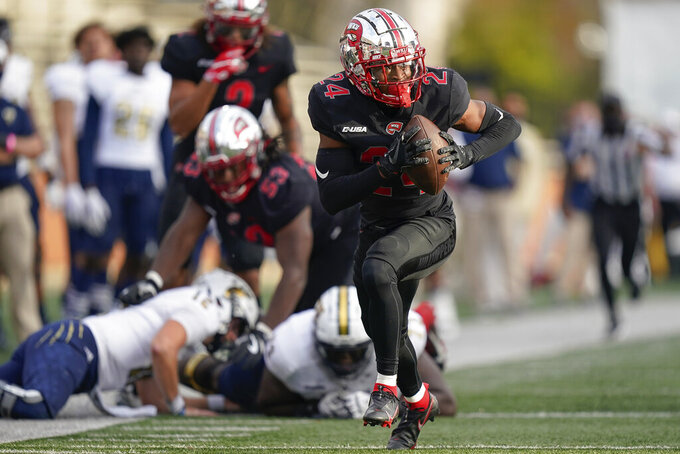 Western Kentucky defensive back Roger Cray (24) runs for a touchdown after recovering a Florida International fumble during the second half of an NCAA college football game Saturday, Nov. 21, 2020, in Bowling Green, Ky. (AP Photo/Bryan Woolston)