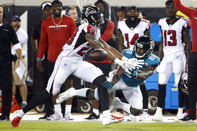 Atlanta Falcons defensive back Jayson Stanley, left, breaks up a pass intended for Jacksonville Jaguars wide receiver Tre McBride (88) during the second half of an NFL preseason football game Thursday, Aug. 29, 2019, in Jacksonville, Fla. (AP Photo/Stephen B. Morton)