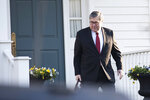 Attorney General William Barr leaves his McLean, Va., home on Monday, March 25, 2019. (AP Photo/Kevin Wolf)