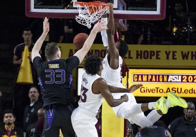 Arizona State's Luguentz Dort (0) dunks next to Washington's Sam Timmins (33) and his Arizona State's Romello White (23) during the first half of an NCAA college basketball game Saturday, Feb. 9, 2019, in Tempe, Ariz. (AP Photo/Darryl Webb)