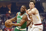 Boston Celtics' Kemba Walker, left, drives against Cleveland Cavaliers' Cedi Osman in the first half of an NBA basketball game, Tuesday, Nov. 5, 2019, in Cleveland. (AP Photo/Tony Dejak)