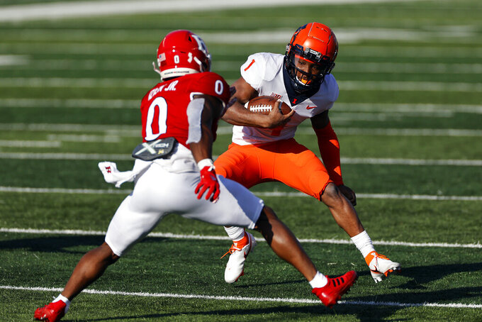 Illinois quarterback Isaiah Williams (1) rushes past Rutgers defensive back Christian Izien during the first half of an NCAA college football game, Saturday, Nov. 14, 2020, in Piscataway, N.J. (AP Photo/Adam Hunger)