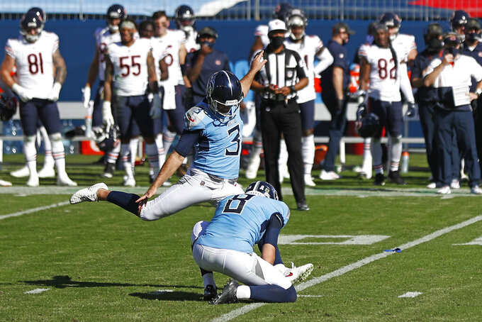 Tennessee Titans kicker Stephen Gostkowski (3) kicks a 40-yard field goal against the Chicago Bears in the first half of an NFL football game Sunday, Nov. 8, 2020, in Nashville, Tenn. Holding is Ryan Allen (8). (AP Photo/Wade Payne)