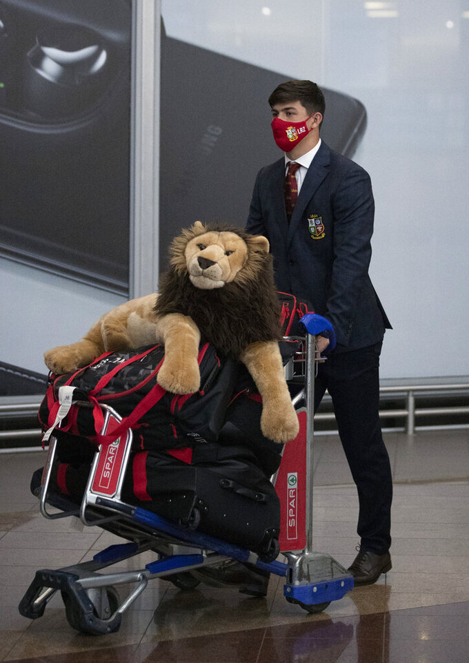 Britain and Irish Lions' player Louis Rees-Zammit with the rugby team arrives at OR Tambo International Airport in Johannesburg, South Africa, Monday, June 28, 2021. (AP Photo/Themba Hadebe)