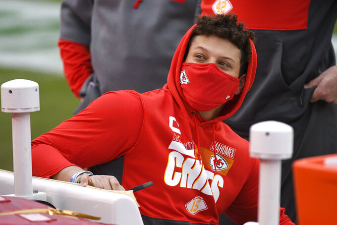 Kansas City Chiefs quarterback Patrick Mahomes sits on the bench before the AFC championship NFL football game against the Buffalo Bills, Sunday, Jan. 24, 2021, in Kansas City, Mo. (AP Photo/Reed Hoffmann)