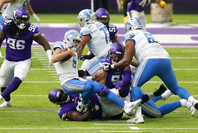 Detroit Lions quarterback Matthew Stafford (9) is sacked during the first half of an NFL football game against the Minnesota Vikings, Sunday, Nov. 8, 2020, in Minneapolis. (AP Photo/Jim Mone)