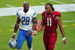 Arizona Cardinals wide receiver Larry Fitzgerald (11) talks with Detroit Lions running back Adrian Peterson (28) after an NFL football game, Sunday, Sept. 27, 2020, in Glendale, Ariz. The Lions won 26-23. (AP Photo/Ross D. Franklin)