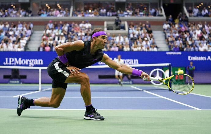 Rafael Nadal, of Spain, returns a shot to Daniil Medvedev, of Russia, during the men's singles final of the U.S. Open tennis championships Sunday, Sept. 8, 2019, in New York. (AP Photo/Eduardo Munoz Alvarez)