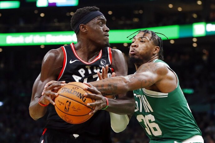 Boston Celtics' Marcus Smart (36) defends against Toronto Raptors' Pascal Siakam during the second half of an NBA basketball game in Boston, Friday, Oct. 25, 2019. (AP Photo/Michael Dwyer)