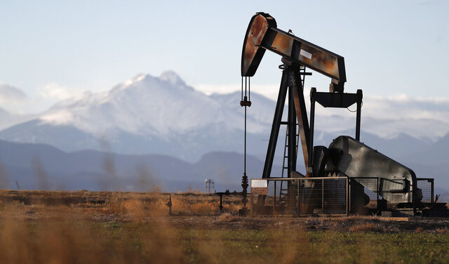 FILE - This Dec. 22, 2018, file photo shows a pump jack over an oil well along Interstate 25 near Dacono, Colo. Federal courts have delivered a string of rebukes to the Trump administration over what they found were failures to protect the environment and address climate change as it promotes fossil fuel interests and the extraction of natural resources from public lands. (AP Photo/David Zalubowski, File)