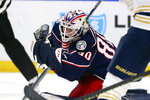 Columbus Blue Jackets goalie Matiss Kivlenieks (80) makes a glove-save during the third period of an NHL hockey game against the Buffalo Sabres, Thursday, Feb. 13, 2020, in Buffalo, N.Y. (AP Photo/Jeffrey T. Barnes)