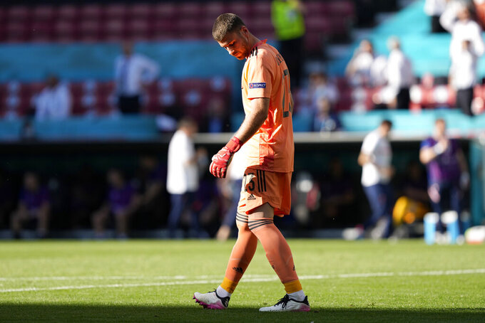 Spain's goalkeeper Unai Simon reacts after taking an own goal during the Euro 2020 soccer championship round of 16 match between Croatia and Spain at Parken stadium in Copenhagen, Denmark, Monday, June 28, 2021. (AP Photo/Martin Meissner, Pool)