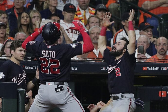 Washington Nationals' Juan Soto celebrates his home run with teammate Alex Bregman uring the fifth inning of Game 6 of the baseball World Series against the Houston Astros Tuesday, Oct. 29, 2019, in Houston. (AP Photo/David J. Phillip)