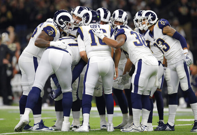Los Angeles Rams players huddle during the first half of the NFL football NFC championship game against the New Orleans Saints Sunday, Jan. 20, 2019, in New Orleans. (AP Photo/Carolyn Kaster)