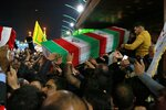 FILE - In this Saturday, Jan. 4, 2020 file photo, mourners carry the coffin of Iran's top general Qassem Soleimani during his funeral in Karbala, Iraq. Iran has vowed