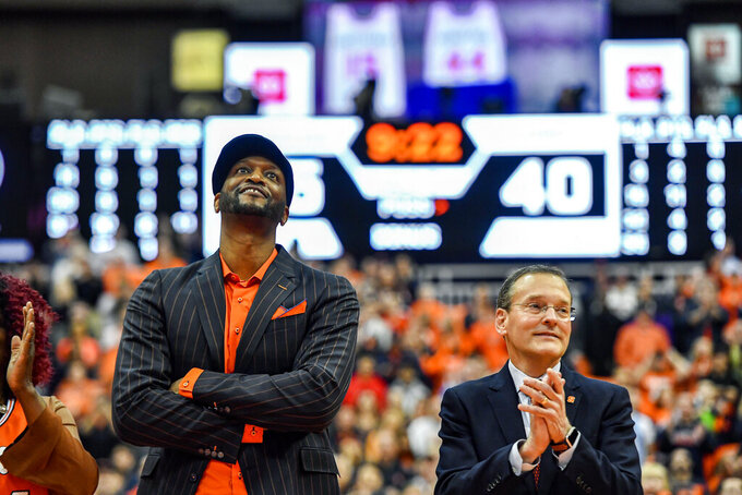 Former Syracuse player John Wallace watches as his jersey is retired and unveiled in the rafters of the Carrier Dome during halftime of an NCAA college basketball game between Syracuse and North Carolina in Syracuse, N.Y., Saturday, Feb. 29, 2020. (AP Photo/Adrian Kraus)