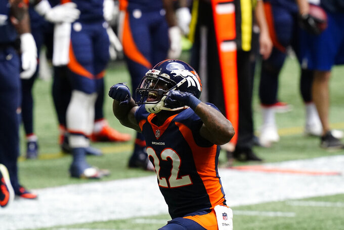 Denver Broncos strong safety Kareem Jackson (22) celebrates a hit against the Atlanta Falcons during the first half of an NFL football game, Sunday, Nov. 8, 2020, in Atlanta. (AP Photo/Brynn Anderson)