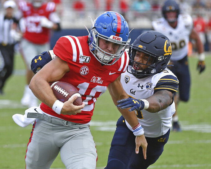 California safety Trey Turner III (5) tackles Mississippi quarterback John Rhys Plumlee (10) during the second half of an NCAA college football game in Oxford, Miss., Saturday, Sept. 21, 2019. California won 28-20. (AP Photo/Thomas Graning)