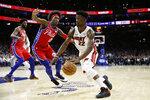 Miami Heat's Jimmy Butler (22) tries to dribble past Philadelphia 76ers' Josh Richardson (0) during the first half of an NBA basketball game, Saturday, Nov. 23, 2019, in Philadelphia. (AP Photo/Matt Slocum)