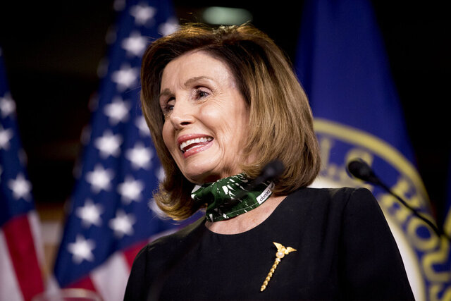 House Speaker Nancy Pelosi of Calif., smiles during a news conference on Capitol Hill, Thursday, May 14, 2020, in Washington. (AP Photo/Andrew Harnik)