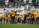 Arizona State players, including Evan Fields (4), celebrate at the conclusion of a win over Michigan State in an NCAA college football game, Saturday, Sept. 14, 2019, in East Lansing, Mich. (AP Photo/Al Goldis)