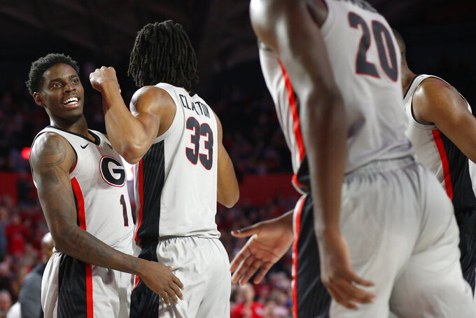 Georgia guard Teshaun Hightower (1) celebrates with forwards Nicolas Claxton (33) and Rayshaun Hammonds (20) during an NCAA college basketball game against Texas in Athens, Ga., Saturday, Jan. 26, 2019. (Joshua L. Jones/Athens Banner-Herald via AP)