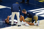 Gonzaga coach Mark Few stands over Jalen Suggs (1) as he is examined during the first half of the team's NCAA college basketball game against West Virginia, Wednesday, Dec. 2, 2020, in Indianapolis. (AP Photo/Darron Cummings)