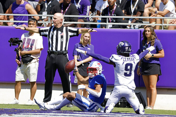 SMU wide receiver Jordan Kerley (1) shows the football on a touchdown that initially was called incomplete, as TCU cornerback C.J. Ceasar II (9) pleads his case during the second half of an NCAA football game in Fort Worth, Texas, Saturday, Sept. 25, 2021. (AP Photo/Michael Ainsworth)