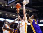 Tennessee and LSU players fight for the rebound during an NCAA college basketball game at Thompson-Boling Arena, Saturday, Jan. 4, 2020,  Knoxville, Tenn. (Brianna Paciorka/Knoxville News Sentinel via AP)