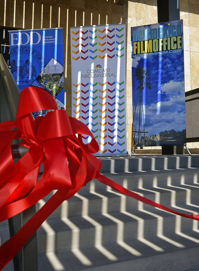 The red ribbon ready for the cutting for the official opening of the NBCUniversal's New Mexico Production Studio, Thursday, June, 24 , 2021, in Albuquerque, N.M. (Jim Thompson/The Albuquerque Journal via AP)