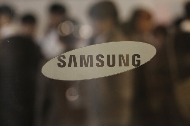 FILE - In this Oct. 31, 2019, file photo, the logo of the Samsung Electronics Co. is seen at its office in Seoul, South Korea. Samsung Electronics Co. said Wednesday, Jan. 8, 2020, its operating profit for the last quarter likely fell 34% from a year earlier, which would be a smaller-than-expected decline possibly resulting from increased smartphone shipments and gradually stabilizing computer chip prices. (AP Photo/Ahn Young-joon, File)