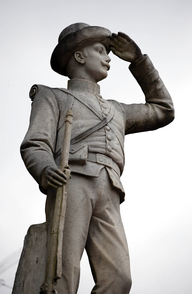 This Feb. 23, 2019 file photo shows the Confederate soldier monument at the University of Mississippi in Oxford, Miss. State officials are considering the University of Mississippi's proposal to move a Confederate soldier monument from a central spot on the Oxford campus to a Confederate cemetery that's still on campus but in a less prominent location.   Trustees of the Mississippi Department of Archives and History are meeting Friday, Dec. 6, 2019 and the proposal is on the agenda. (AP Photo/Rogelio V. Solis, File)