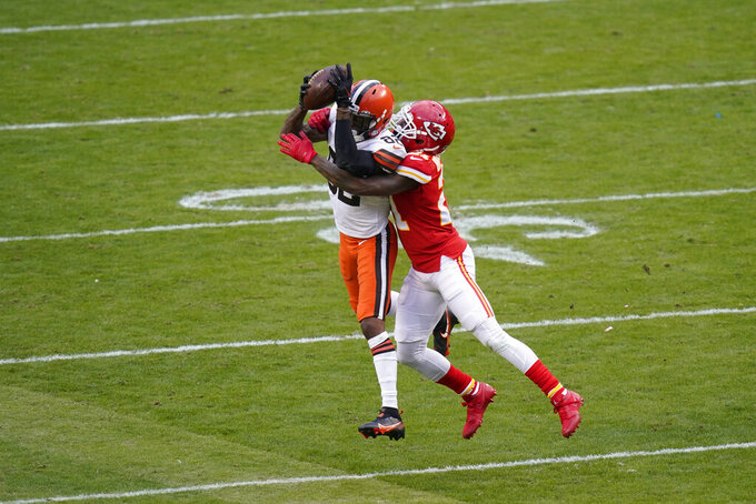 Cleveland Browns wide receiver Rashard Higgins, left, catches a pass in front of Kansas City Chiefs cornerback Bashaud Breeland, right, during the second half of an NFL divisional round football game, Sunday, Jan. 17, 2021, in Kansas City. (AP Photo/Orlin Wagner)