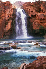 FILE - This 1993 file photo shows Havasu Falls in the Grand Canyon, Ariz. About 200 tourists are being evacuated from a campground on tribal land near famous waterfalls deep in a gorge off the Grand Canyon. Officials with the Havasupai Tribe say their reservation was hit with two rounds of flooding Wednesday, July 11, 2018, and early Thursday. (The Arizona Republic via AP, File)